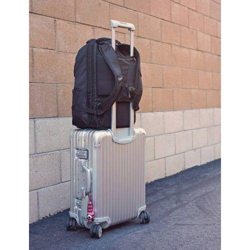 Luggage handle pass through back panel